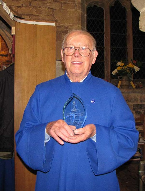 Ken Heywood with his award