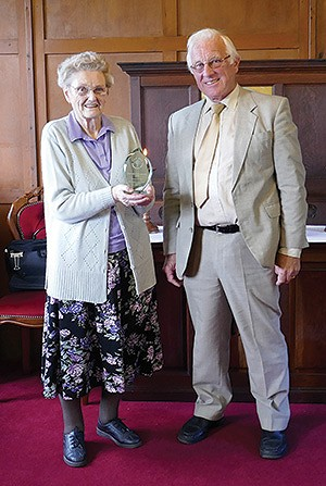 Doreen Mason is presented the award by Stan Smith
