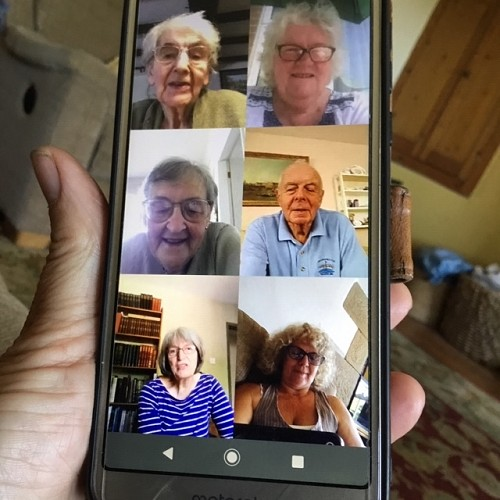 mobile phone with video call of six people