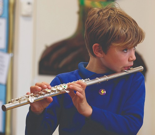 child playing the flute