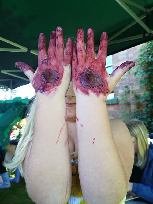 child with blackberry stained hands