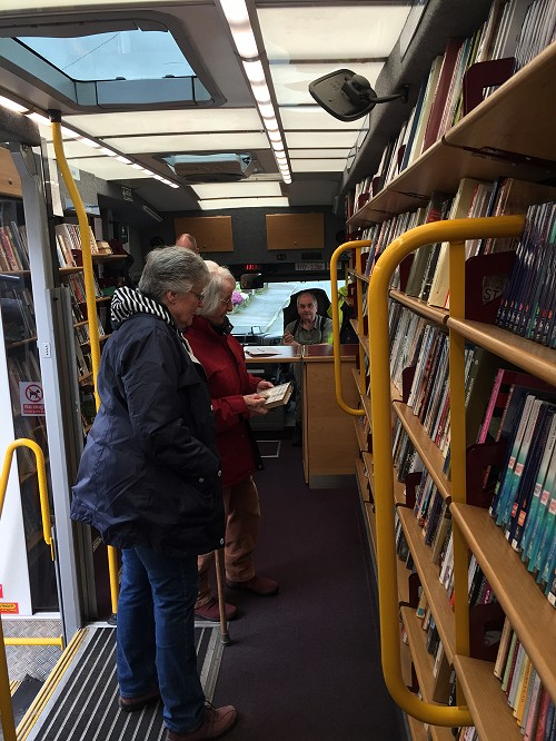 People choosing books on the Mobile Library bus