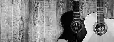black and white picture of two acoustic guitars