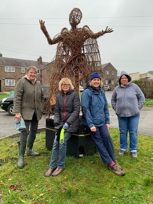 Some of Crich Willow Weaving Group with the sculpture of the angel.