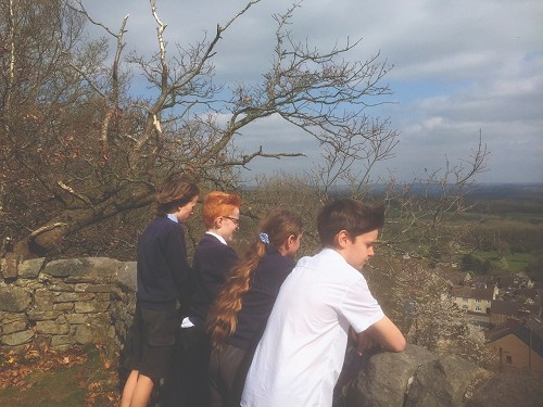 Junior school children enjoying a view over Crich