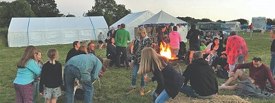 People enjoying an evening outdoors at Whatstandwell Festival